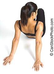 Shoulder Stretch - A females fitness instructor demonstrates...
