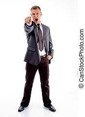 shouting adult businessman pointing at camera