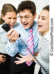 Shouting in telephone receiver - Closeup of three business...