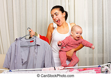 Shouting multi-tasking mother - Screaming young mother fed...