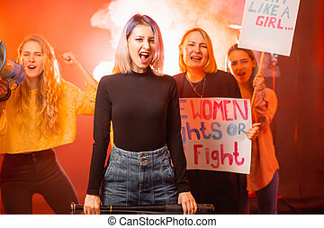 shouting young girls with posters promoting feminism