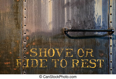Shove or Ride to Rest painted on an old train car