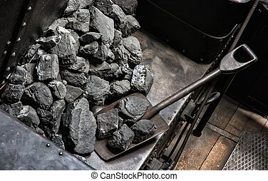 Shovel and coal in historic steam locomotive