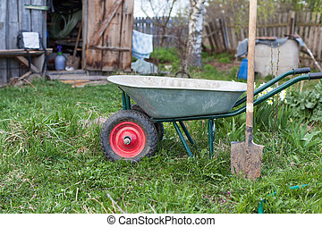 Shovel and the cart on a garden site