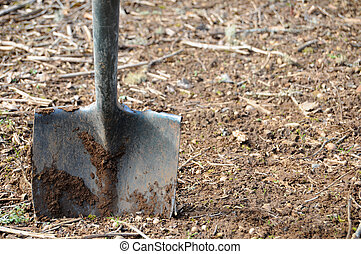 Shovel in Dirt - A shovel stuck in dirt. It appears to have...