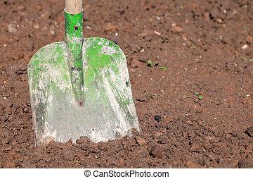 Shovel in soil in a garden