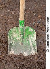 Shovel in the dirt in a garden