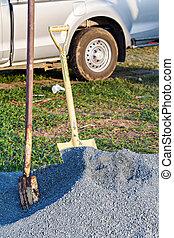 Shovel on a heap of gravel