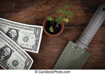 Shovel Pot Money on a wooden floor