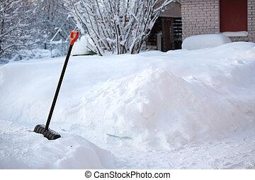shovel snow  - shovel in snow on nature