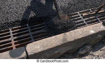 Shovel throwing asphalt.