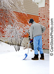 Shoveling Snow After an Ice Storm - Shoveling Snow - A man...