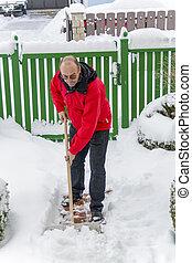shoveling snow at man