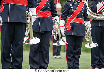 Show band with live music playing wind instruments in uniform, mellophone