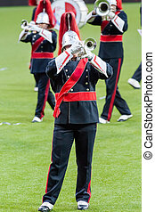 Show band with live music playing wind instruments in uniform