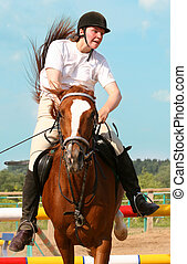 show jumping - The girl skips on a horse