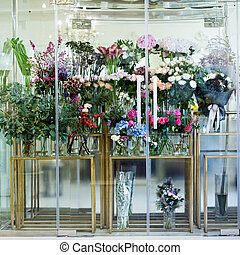 Showcase in the flower shop. Many bouquets of flowers.