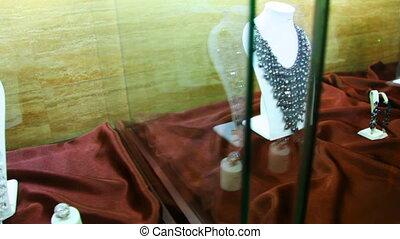 Showcase jewelry on neck in one store in salon Estet -...