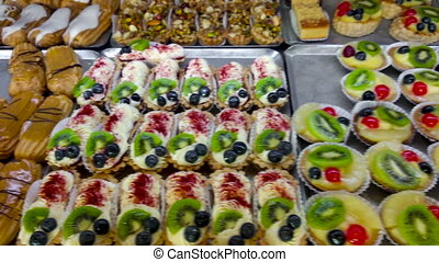 Showcase With Cakes On Display In Pastry Shop And Bakery....