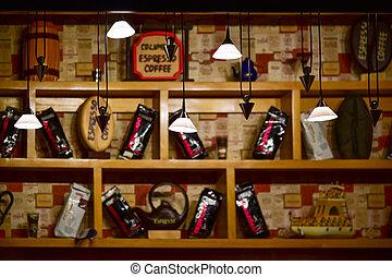 Showcase with coffee in a loft-style coffee shop bar