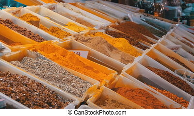 Showcase with Colorful Oriental spices and condiments on the...