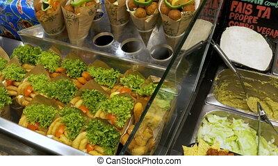 Showcase with Fast Food in La Boqueria. Barcelona. Spain....