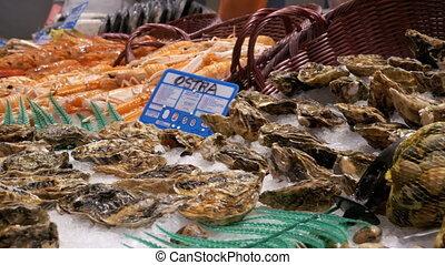 Showcase with Fresh Seafood in La Boqueria Fish Market....