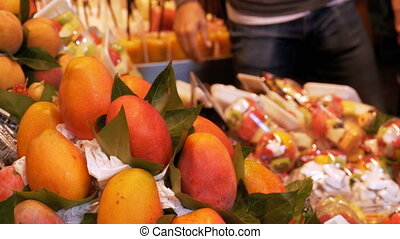 Showcase with Fresh Tropical Fruits and Vegetables in La...