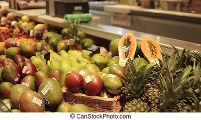 Showcase with mango and papaya