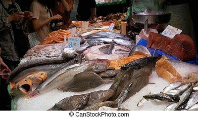 Showcase with Seafood in Ice at La Boqueria Fish Market....