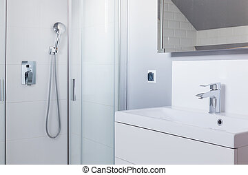 Shower and wash basin in white toilet