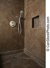 shower corner - hand shower equipment on brown wall of ...