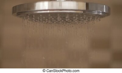Shower flowing in close-up and slow motion.
