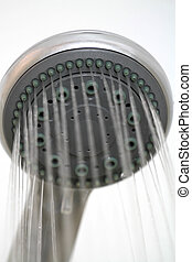Shower head while running water on white background