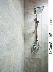 Shower on wall - Vertical view of small shower on marble...