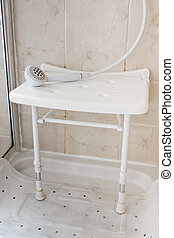 Shower seat - White Plastic shower seat used by the elderly ...