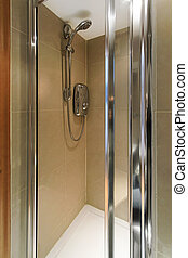 Small marble shower cabin with water heater