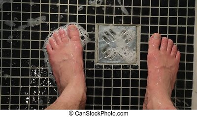 Shower water flowing on feet