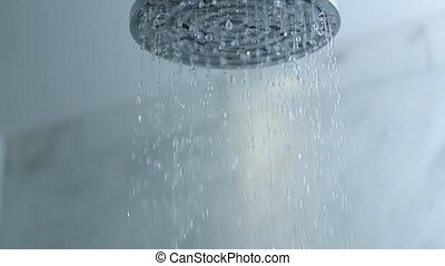 Shower water flowing, slow motion from 120fps footage