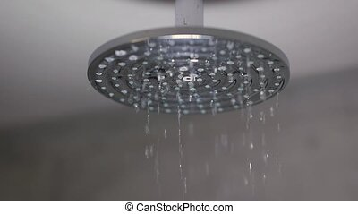 Shower water flowing - Turning on the shower, slow motion ...