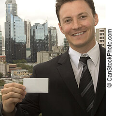 Showing a Business Card - A man is showing his business card...