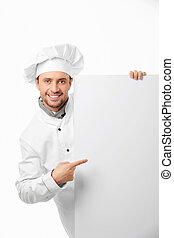 Attractive cook shows on a white background
