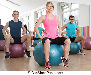 Showing exercise on fitness ball