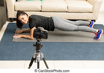 Showing how to do planks on her vlog