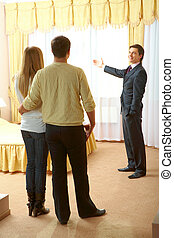Showing new flat - Confident businessman showing new flat to...