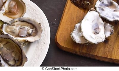 fresh raw oysters - showing opne fresh raw oysters and its...