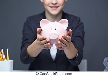 Showing piggy bank