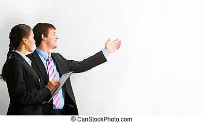 Showing - Portrait of businessman pointing at wall with ...