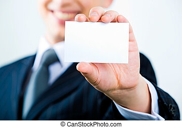 Showing visiting card - Image of business man holding a...