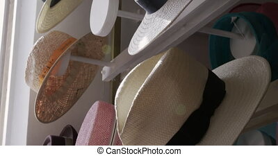 Showroom at a hat factory - Close up of straw hats, trilbys ...